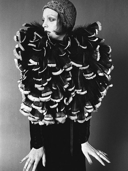 Groupie Karen Seltenrich poses in a feather costume, San Francisco, CA, March 1970.