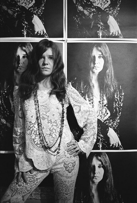 American singer Janis Joplin (1943-1970) poses at her home in front of a Bob Seidemann poster in Haight-Ashbury, San Francisco, November 1967.