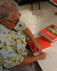 william-signing-books