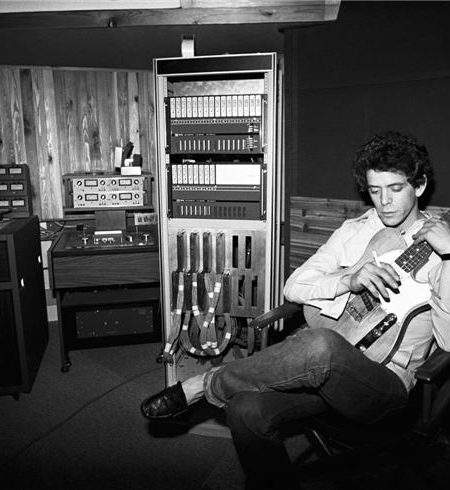 Lou Reed looking down holding guitar in Recording Studio NEW YORK CITY, 1977