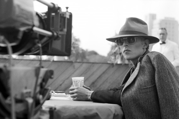 Singer David Bowie wearing a smart hat and sunglasses during the filming of 'The Man Who Fell To Earth' in Los Angeles, 1975.