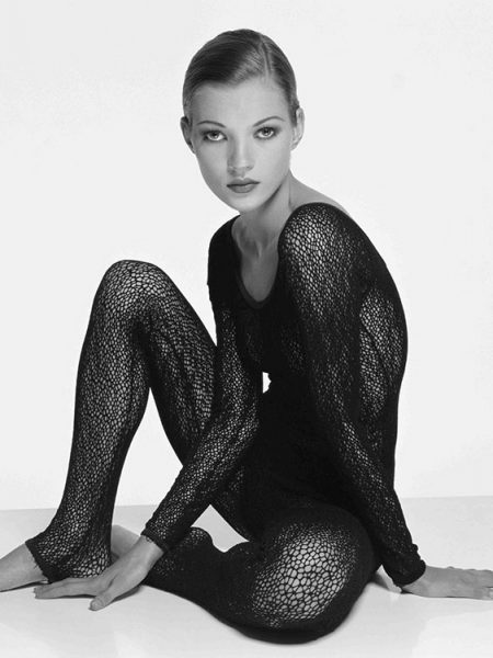 English fashion model Kate Moss in a black body stocking, March 1993.